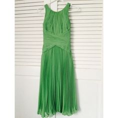 NWOT Green Long Anne Klein Dress An Anne Klein original long tiered green dress. Never been worn - purchased without receipt and it just didn't fit right. Is a 4 but fits between a 2-4. 100% silk. Can be dressed up and down. Make me an offer:) Anne Klein Dresses Maxi