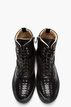 ALEXANDER MCQUEEN Buffed black leather covered stud sneakers