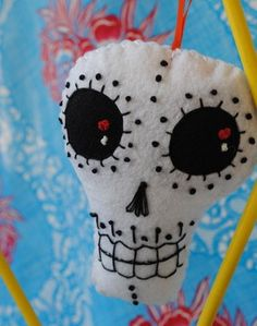 Hand Embroidered White Sugar Skull Ornaments Modern Folk Art- Perfect for Halloween Orange and Black Accents. $18.00, via Etsy.
