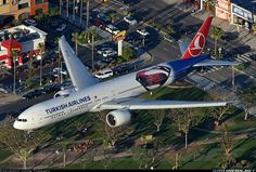 """Turkish Airlines Boeing 777-3F2/ER TC-JJN """"Anadolu"""" on final approach to Los Angeles-International, February 2016. Special livery promoting the release of """"Batman v Superman: Dawn of Justice"""" can be seen aft of the wings. (Photo: Jacob Thomsen)"""
