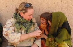 Australian soldier Private Lauren Meade and two Afghan girls. Photo: Corporal Neil Ruskin