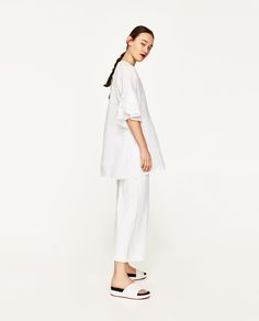 LINEN TUNIC WITH FRILLS