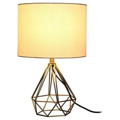 25 Decor Pieces Under $50 to Glam Up Any Room: TARGET GEOMETRIC METAL SMALL TABLE LAMP. This lamp is small enough to blend in without dominating the room, but large enough to make a statement. ($24.99; Target)