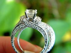 Ribbon styled engagement ring by Kirk Kara. Hand-carved white gold. Antique styled engagement ring.
