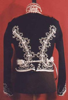 View of the back side of a replica Prussian Lieb Hussar Officer's uniform tunic, circa 1813.