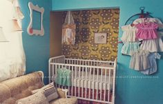 save space in baby's nursery by removing the doors from the sliding closet. Wallpaper, crib, and viola!