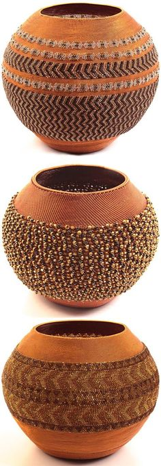 Southern Africa | Wire and glass bead basket from KwaZulu Natal, South Africa. These pot-shaped baskets are created only by masterweavers. First they make a traditional piece of pottery and then begin...