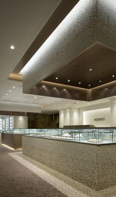 "x mosaic tile makes it possible to show ""Lightness"" and something ""Floating"" for its heavy solid surface. Jewellery Shop Design, Jewellery Showroom, Jewelry Shop, Jewelry Rings, Showroom Interior Design, Public Space Design, Counter Design, Shops, Shop Interiors"