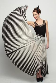 Love the geometric print 7 inserts but don't care for the top or the expression of the model...