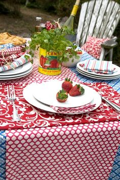 Casual Memorial Day Tablescape |   Hen House Linens. I like the idea of the tomato can as a planter for center piece.