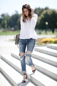 distressed denim and white blouse