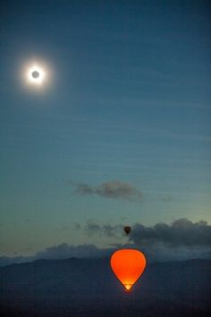 Cairns Solar eclipse as seen from a fleet of Hot Air Balloons flying over the Atherton Tablelands