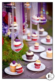 what an amazing way to display cupcakes at a wedding reception...hanging from colorful ribbons!