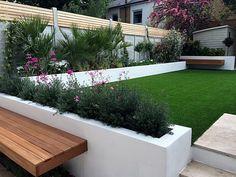 Modern garden design Fulham Chelsea Clapham grass travertine paving Peckham