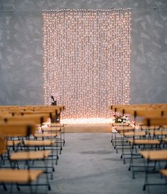 An eye-catching ceremony backdrop doesn't need to cost a fortune. Try draping white Christmas lights from an extended cable for a simple yet stunning backdrop.