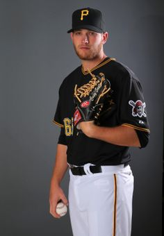 BRADENTON, FL - FEBRUARY 21: Casey Sadler #65 of the Pittsburgh Pirates poses for a portrait during the Pittsburgh Pirates Photo day on February 21, 2014 at Pirate City in Bradenton, Florida. (Photo by Elsa/Getty Images)