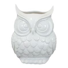 "Ceramic owl decor in white.      Product: Owl decorConstruction Material: CeramicColor: WhiteDimensions: 9"" H x 7"" W x 6"" D"