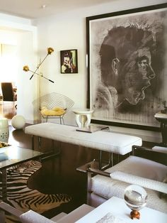 Large scale artwork, lighting + faux ostrich leather chair.