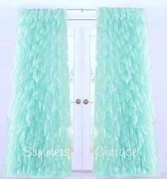 These sheer voile curtains display an extravagance of ruffles for ...