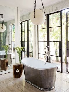 Bathroom with a Waterworks cast iron bathtub, and a antique alabaster pendant