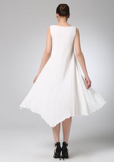 This white linen mini dress is the perfect transition piece from spring to autumn. The asymmetrical seam adds a unique flair and the wide scoop neck will show off your neckline.it is a cute prom mini dress, this will be a fabulous addition to your wardrobe. * Our Best sale white dress http://etsy.me/1pkAsyv * 2016 New white dress http://etsy.me/1Thwwvc DESIGN FEATURES * Super soft linen fabric * Sleeveless * Unique, asymmetrical seams * length is approximately ...