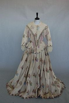 An 1850s chine silk taffeta gown, the ivory silk, front view