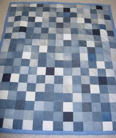 """These quilts are made out of 5""""x5"""" squares cut out of old pairs of jeans. They can be cut out of any article of clothing or any other cloth. This quilt is also backed in fleece. The jean quilt is a bit heavier than other fabrics."""