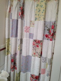 Patchwork shower curtain.  Do in cotton (from sheets and pillowcases, etc.) in white, aqua, yellow, coral,  Sew with raw edges on the outside.