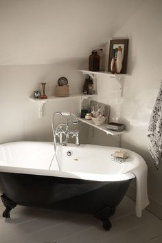 Improvised corner bath. Love the haphazard shelving.