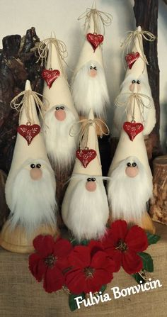 Learn to make these sweet Holiday Gnomes out of fleece and foam cones! Super easy craft for the holiday season.Ever since a visit to Denmark I really liked the Scandinavian Christmas gnomes (or tomte, nisse.) for decoration during the holiday period. Christmas Gnome, Rustic Christmas, Christmas Projects, Christmas Ornaments, Elegant Christmas, Felt Crafts, Holiday Crafts, Diy And Crafts, Recycled Crafts