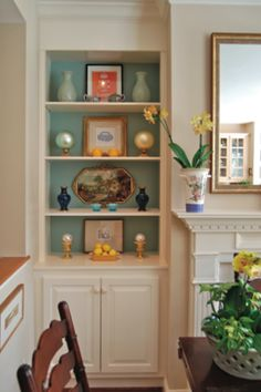 shelves with aqua interior, white exterior -- would really give our guest room a nice pop