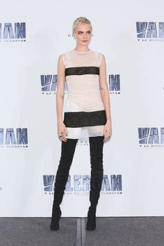 Cara Delevingne rocked thigh high black suede boots and a sheer dress at the Valerian photo call.