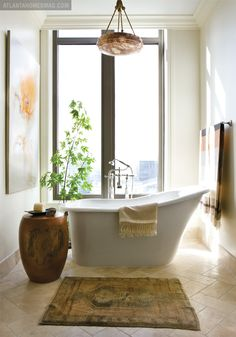love the stone floors (herringbone pattern) cool shape for tub. wall color etc.