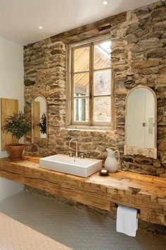 what a Bath room... Stone walls... LOVE IT
