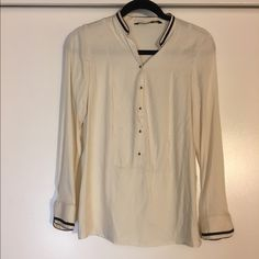 Button Up Zara Shirt Beautiful cream 3/4ths button up top. Brand is Trafalux in the MMXII collection by Zara. With a beautiful black and burgundy trim around the necks and cuffs. Great condition I'm also open to offers on this item as well! Zara Tops Blouses