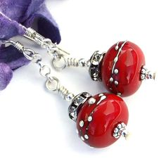 "The blazing ""Cherry Bomb"" #handmade #earrings were created with artisan #lampwork glass beads with fine silver dots, sparkling Czech crystal rondelles, sterling chain and sterling silver. @ShadowDog #ShadowDogDesigns #Indiemade"