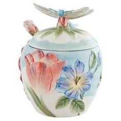 """Showcasing a blooming floral motif and a dragonfly-topped lid, this charming earthenware jar and spoon set brims with garden inspiration.    Product: Jar and spoon setConstruction Material: EarthenwareColor: MultiFeatures: 12 Ounce capacity Dimensions: 4.75"""" H (jar)"""