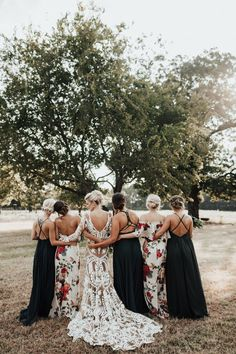 Floral prints and deep greens complete this gorgeous barn wedding's look | Image by In Frames Photography  #fallwedding #barnwedding #bridesmaidgowns #bride