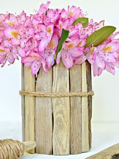 Collect driftwood on your next beach vacation and glue the pieces onto a cylindrical vase.
