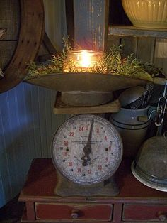 Old scales...a favorite accent of mine!!  Decorate with seasonal touches or fill with mini candy bars, etc!!!   Awesome!