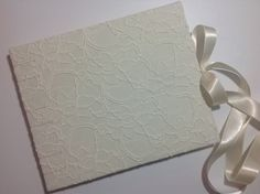 Floral Cream Lace Wedding Guest Book - Handmade Coptic Stitched. $59.00, via Etsy.