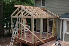 DIY Screened in Porch | Screened porch project-two-more-rafters-go.jpg