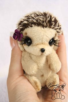 OMG this hedgehog is gorgeous!!!! And she has a rose on her head!!!!!!!!! I want it!!! But the link says it's no longer available :'(