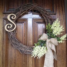 """Spring/Summer wreath. Was planning on painting the """"S"""" pale yellow to coordinate with the floral, but am kind of liking the way the natural wood blends with the burlap. Thoughts?"""