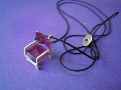 Sterling silver handmade chair. The colour is enamel. The pendant is almost 20 cm. long. (www.giftforever.gr)