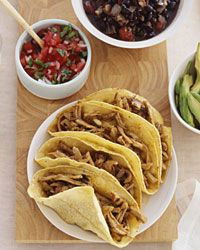 I'm going to tweak this for dinner tonight!  Soft Pork Tacos with Spicy Black Beans Recipe from Food & Wine