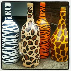 Animal print painted wine bottles.