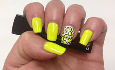 Neon yellow nails with animal print accent
