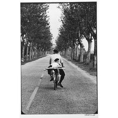 Boy With Baguette: Elliott Erwitt