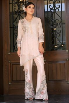 New Arrival Design 2019 Peach sequined embroidered double layered top with flower and pearl embroidery on neckline. Peach raw silk trousers with flower, pearl and accessories embroidery. Available to order as boot cut or straight trousers. Stylish Dresses, Casual Dresses, Girls Dresses, Fashion Pants, Fashion Dresses, Pakistani Dresses Casual, Designs For Dresses, Indian Designer Wear, Indian Outfits